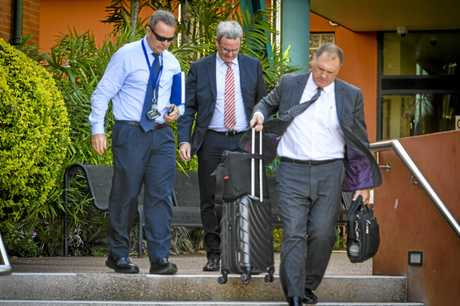Representatives from the Department of Environment and Science leave Gladstone Magistrates Court after the prosecution of Orica Australia Pty Ltd.