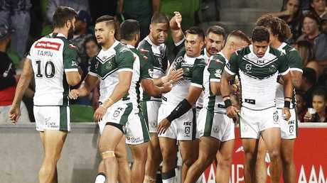 Maori players celebrate a try.