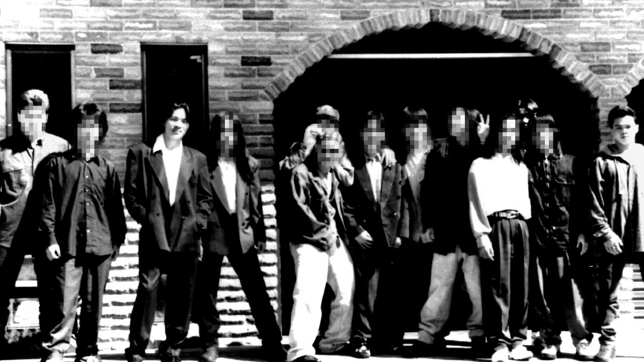 Members of the 5T gang on their way to a meeting in Cabramatta in 1995. Leader Tri Minh Tran, third left, and Minh Nguyen, right, were killed during a gang power struggle. Picture: Supplied