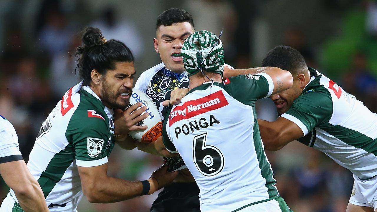 The Indigenous All Stars' David Fifita is tackled by Kalyn Ponga and teammates. Picture: Mike Owen/Getty Images