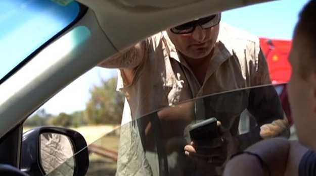 Farmer Jason Parravacini clashes with vegan activist James Warden on his property in Harvey in Western Australia.