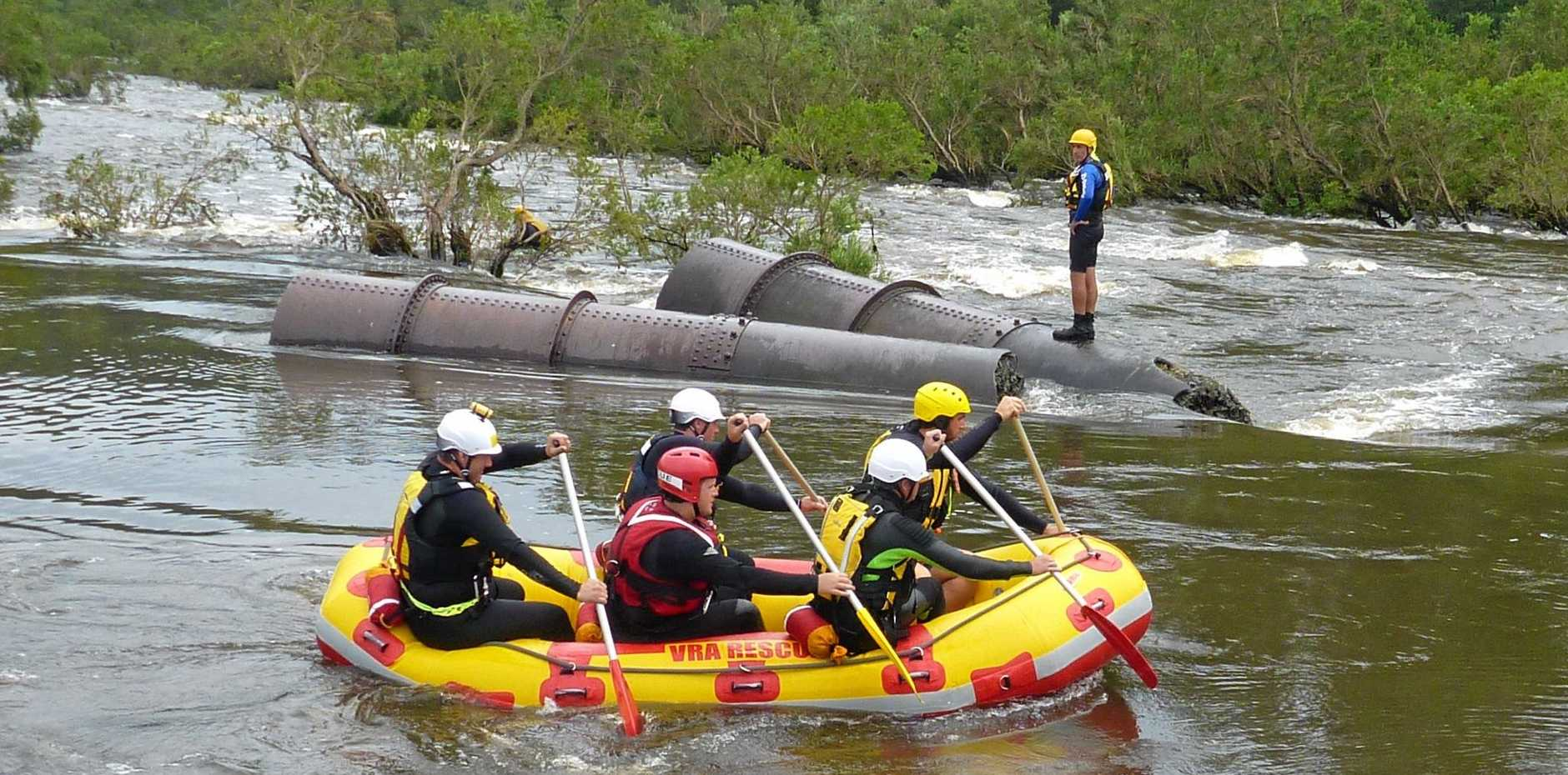 WILD WATER: Volunteer Rescue Association members taking part in swift-water training on the Mann River.