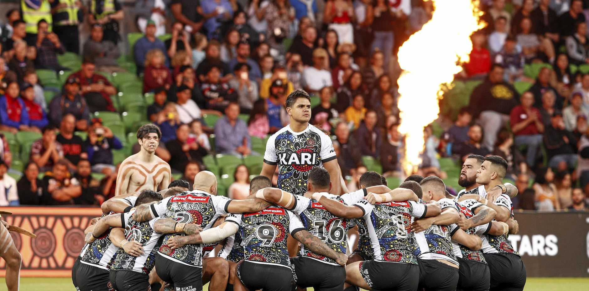 Indigenous players perform a traditional war cry ahead of the NRL Indigenous All-Stars versus New Zealand Maori in Melbourne on Friday night. Picture: Daniel Pockett/AAP