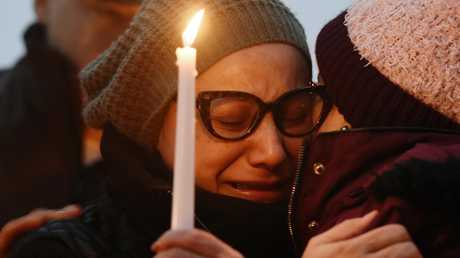 Valerie Reyes' mother, Norma Sanchez, grieves for her daughter during a candlelight vigil. Picture: Tyler Sizemore/Hearst Connecticut Media via AP