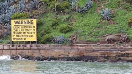 A warning sign on the edge of Alcatraz Island.