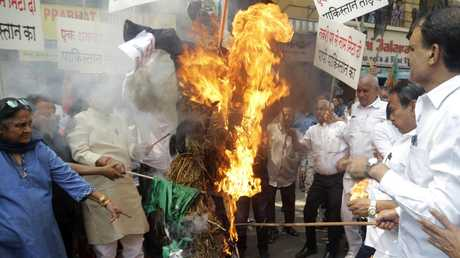 Workers from India's ruling Bharatiya Janata Party burn a symbolic effigy of Pakistan as part of protest against Thursday's attack. Picture: Rajanish Kakade/AP