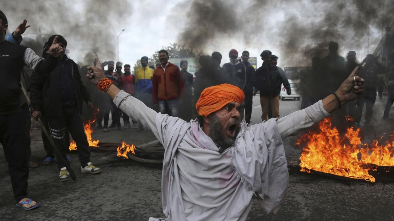 A protester shouts slogans against Thursday's attack on a paramilitary convoy, in Jammu, India on Friday. The death toll from a car bombing on the paramilitary convoy in Indian-controlled Kashmir has climbed at least 40, becoming the single deadliest attack in the divided region's volatile history, security officials said. Picture: Channi Anand/AP