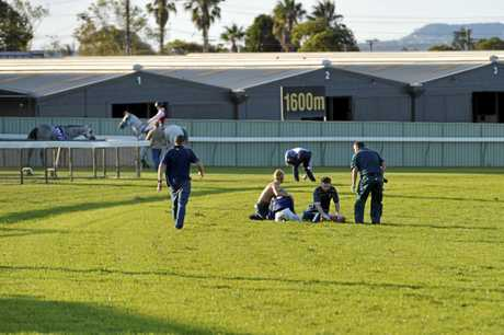 Apprentice Madeleine Wishart is attended to by paramedics after falling from Top Luck after the finish of Saturday's Three-Year-Old Handicap at Clifford Park.