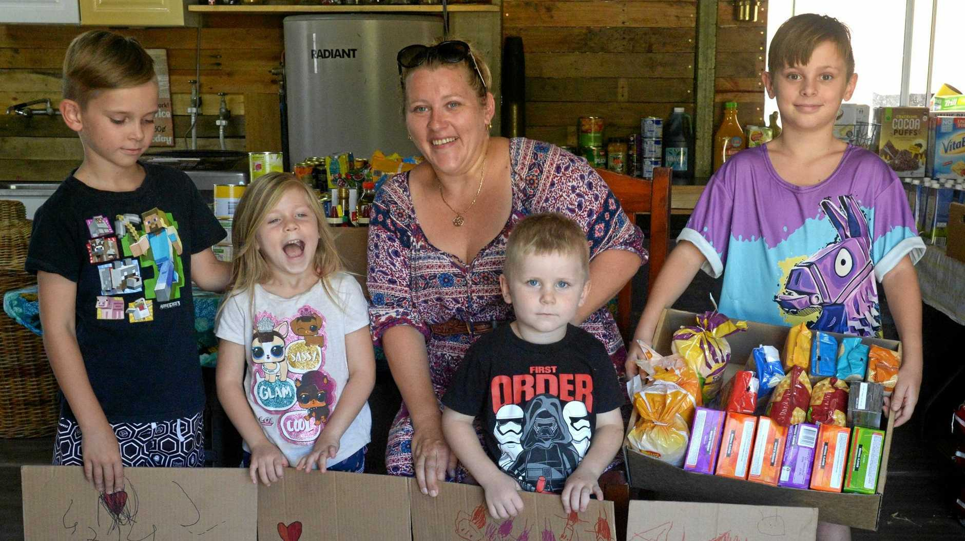 BIG RELIEF: Aldyn, Nyah, Melissa, Eli and Kaylan Murphy are collecting goods for Queensland farmers impacted by recent floods