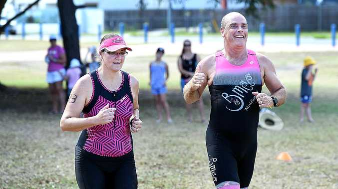 Etienne van Niekerk (right) and wife Debbie finish the intermediate triathlon at Seafront Oval, his first triathlon back after suffering a heart attack in April 2018.