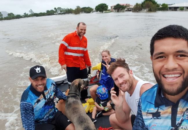 North Queensland players helping Townsville residents during the floods.