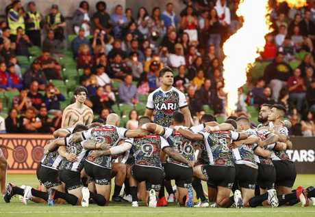 Indigenous players perform a traditional war cry, led by Latrell Mitchell.
