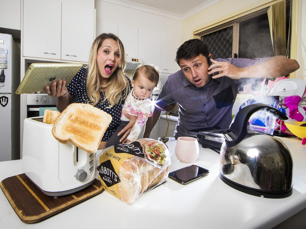 Queenslanders Aline and Marco Pratts,  with their daughter Summer,  are fed up with high electricity prices. Picture: Nigel Hallett