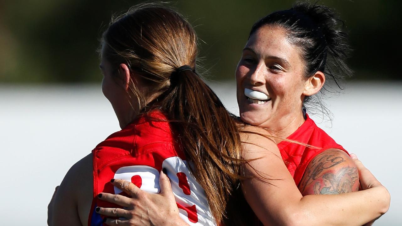 Eden Zanker and Tegan Cunningham celebrate a goal during Melbourne's win. Picture: AFL Media