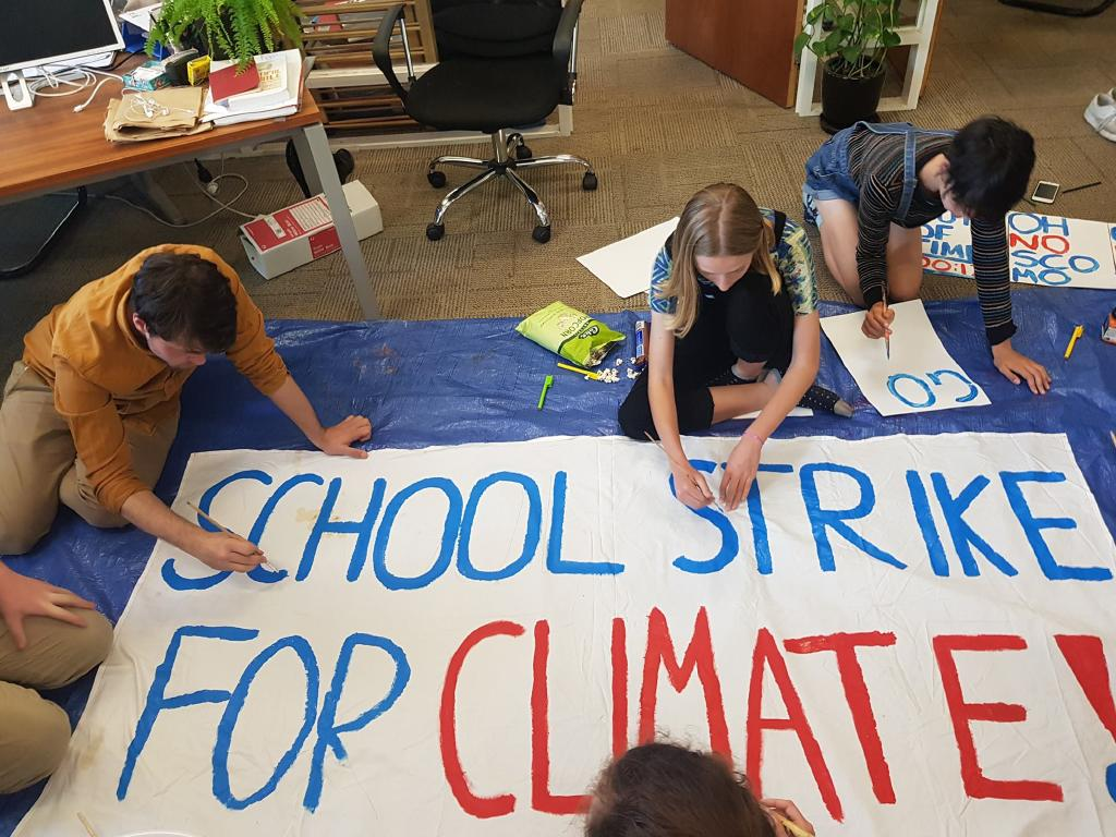 Children being taught to make protest posters and banners by the AYCC NSW at their Redfern Headquarters before the previous Student Strike last November. Picture: Facebook