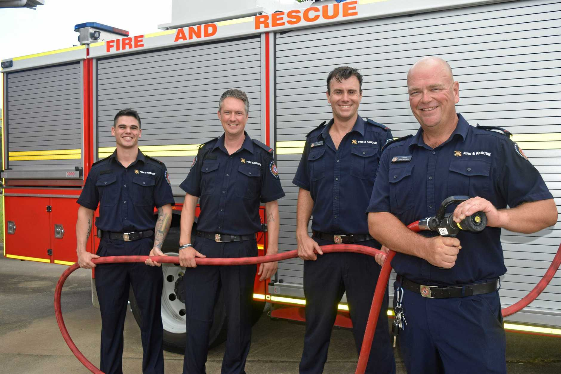 Airlie Beach firefighters Kyle McCormack, Kevin Stokes, Phil Hendry and Derek McAlister are ready for the fire station's open day on February 23.