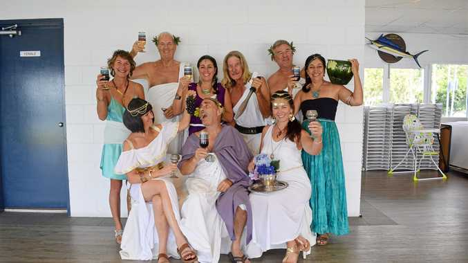 TIME TO TOGA! (Back, from left) Michelle Kach, Dewi Hughes, Julie Adamson, Ron Robert, Marti Davy, Sonja Mason, (front) Heather Batrick, Alan Cormey and Brigitte Peel are ready for the VMR Whitsundays toga party.