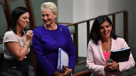 Kerryn Phelps (centre) with Lindsay MP Emma Husar and Chisholm MP Julia Banks on Monday. Picture: AAP