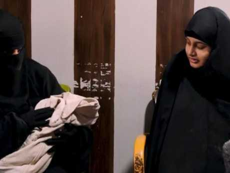 Shamima Begum (right) looks on as another woman holds her newborn son in an interview with Sky News. Picture: Sky News