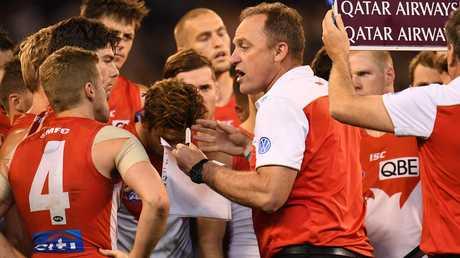Sydney coach John Longmire talks to his players.