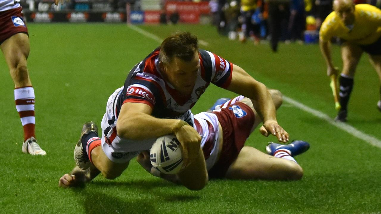 Brett Morris bagged a hat-trick in the first half of his Sydney Roosters debut to stun Wigan. Picture: Getty