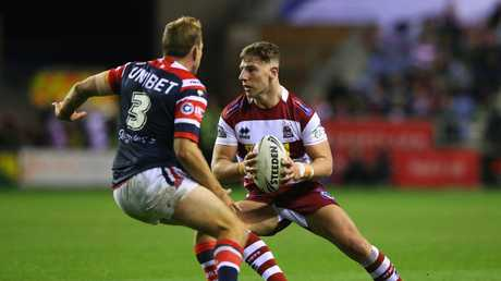 Wigan's George Williams tries to get back Mitchell Aubusson during the first half. Picture: Getty
