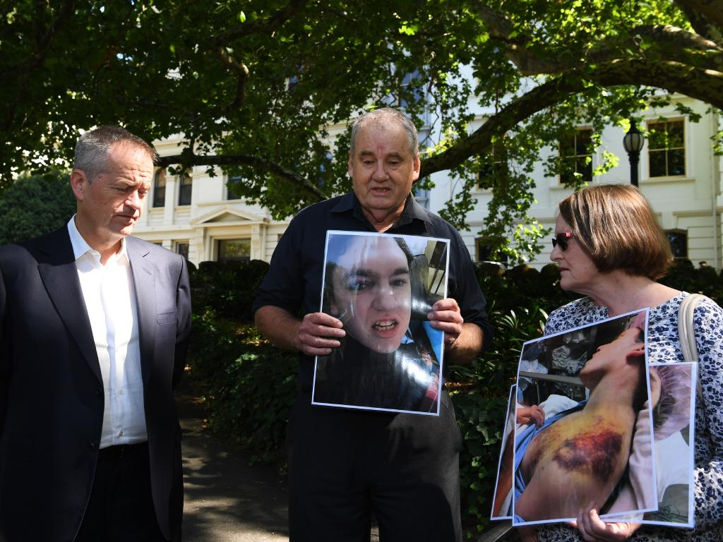 Opposition Leader Bill Shorten with parents holding photos of their 33-year-old son who was abused in the care of the Victorian Department of Human Services in Melbourne last Saturday. Picture: AAP