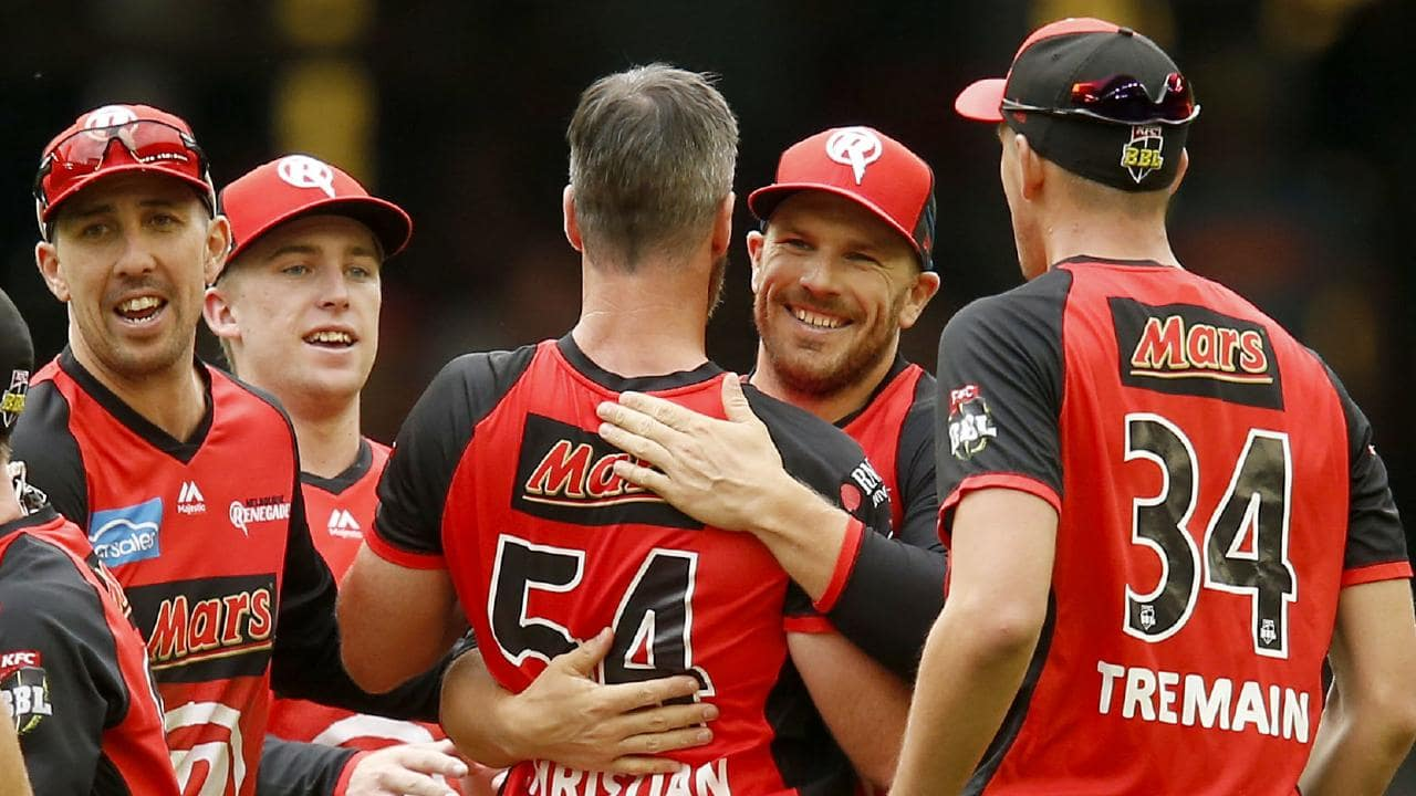 Aaron Finch celebrates with his Renegades teammates after their shock win.