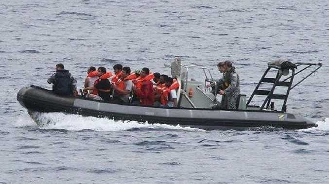 Asylum seekers from a capsized boat are brought ashore on Christmas Island.