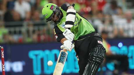 Thunder's Jason Sangha lofts over cover during BBL match between the Sydney Thunder and Melbourne Renegades at Spotless Stadium. Picture. Phil Hillyard