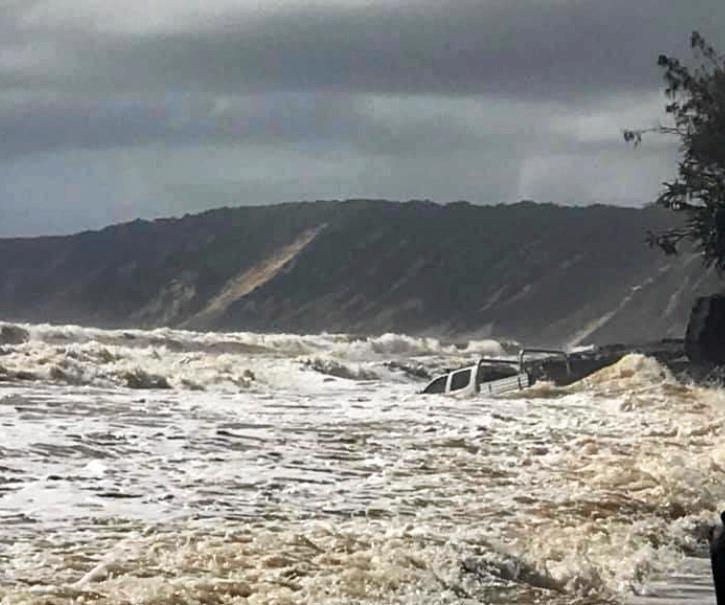 A driver this morning gambled and lost attempting to go round the Mudlo Rocks at Rainbow Beach just before high tide.