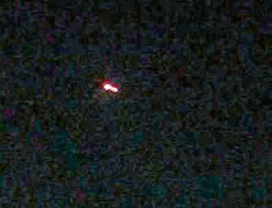 A Glenwood man says he's seen what looked like a UFO hovering near the mountains last night. (A Gladstone man took this photo of an object flying over Tannum Sands).
