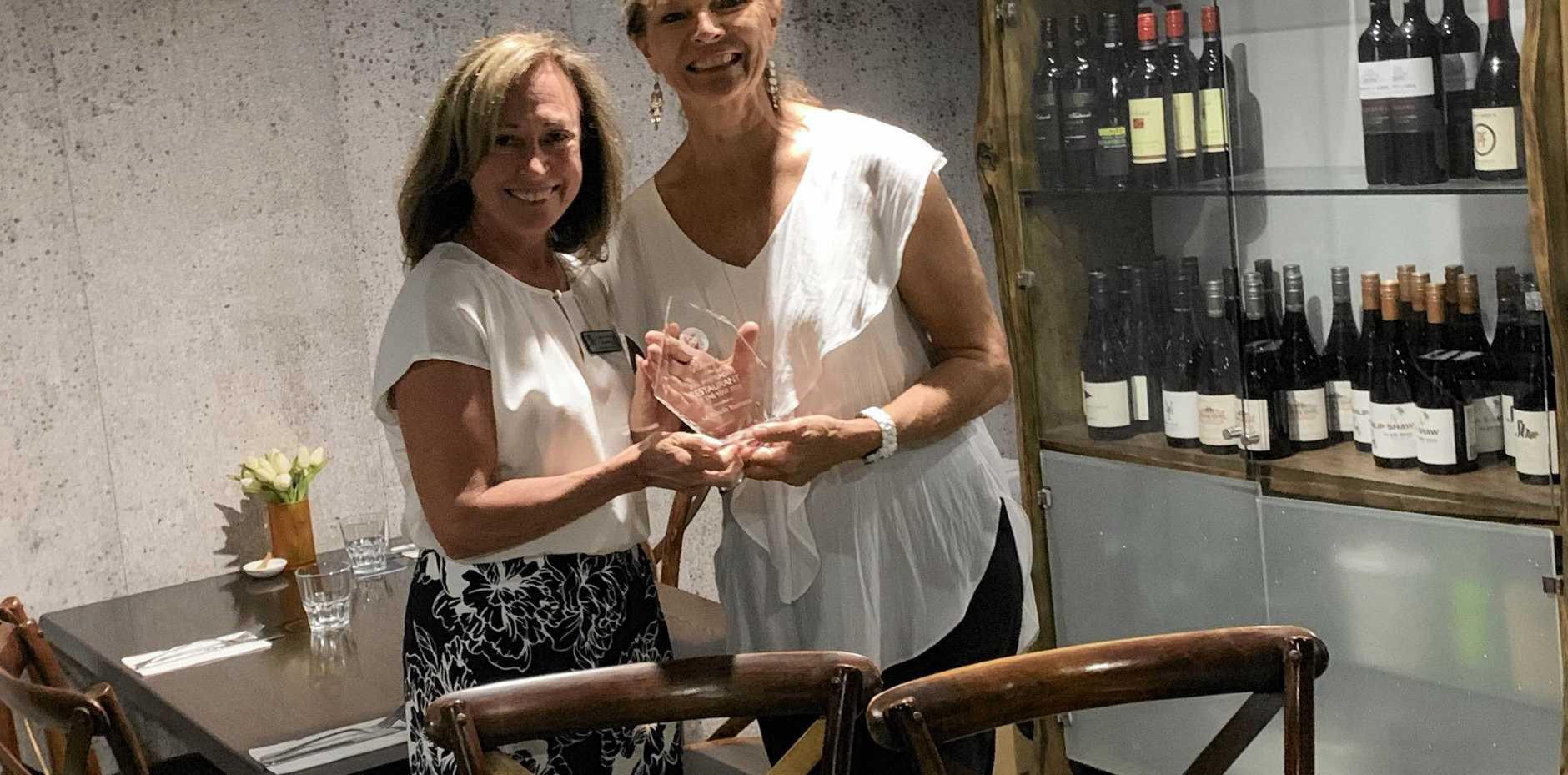 HONOURED: Skal Whitsundays president Carolyn Upton (left), presents La Tabella owner Leni Fries with the Skal Whitsunday 2018 Restaurant of the Year award.