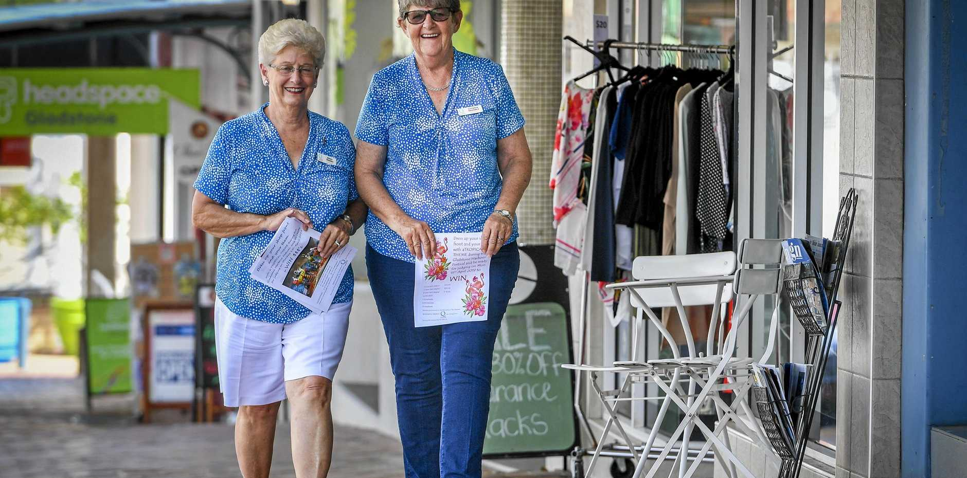 QUOTA Club of Gladstone secretary Aileen Weeden and club president Christine Saunders have been distributing flyers for Tropical Wednesday on Goondoon Street.