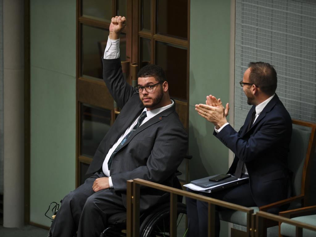 Australian Greens Senator Jordon Steele-John celebrates after the passing of the motion on the disability abuse royal commission. Picture: Lukas Coch/AAP