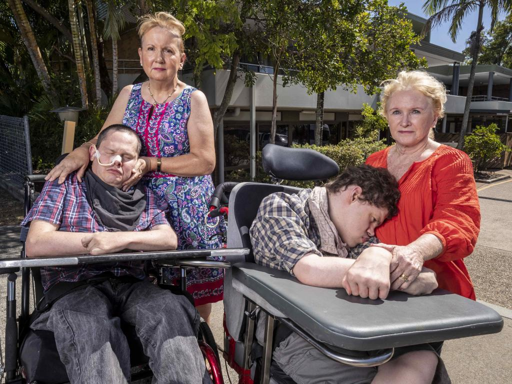 Patricia Dear and her son Kieran and Julie O'Connor with her son Rory outside the Halwyn Centre. Picture: Glenn Hunt/The Australian