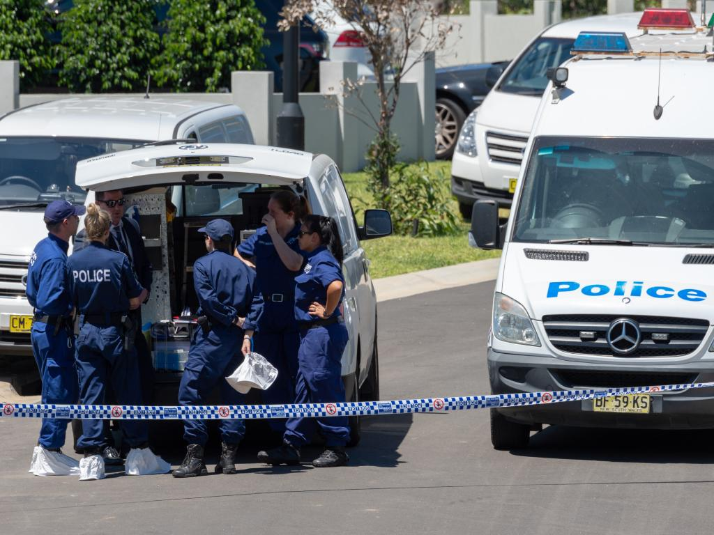 Police at the scene of the home. Picture: Monique Harmer