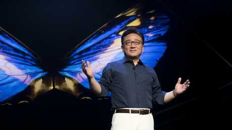 Samsung mobile communications president DJ Koh presents technology at the company's annual developer conference in 2018.