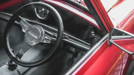 Swind E Classic Mini's interior maintains the car's retro charm.