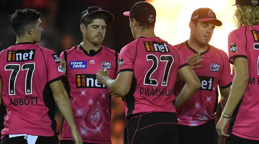 Sixers players commiserate after bowing out in a thriller to the Melbourne Renegades. Picture: Julian Smith/AAP