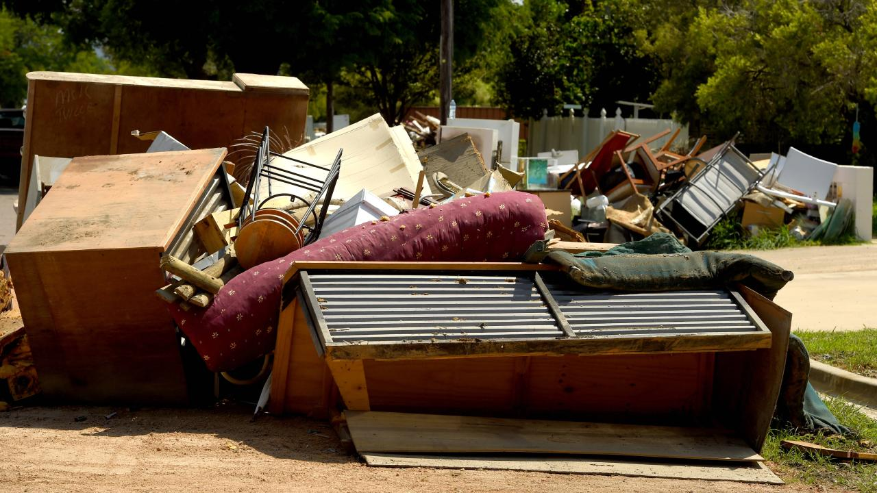 Household debris still piled in on the side of the road in Hermit Park following the devastating Townsville floods. Picture: Evan Morgan