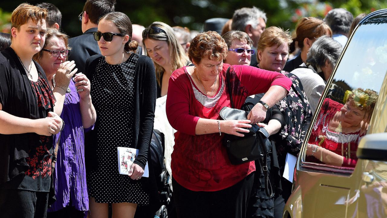 Grieving mourners at the funeral for Mary Lockhart and her son Greg Holmes. Picture: Jake Nowakowski