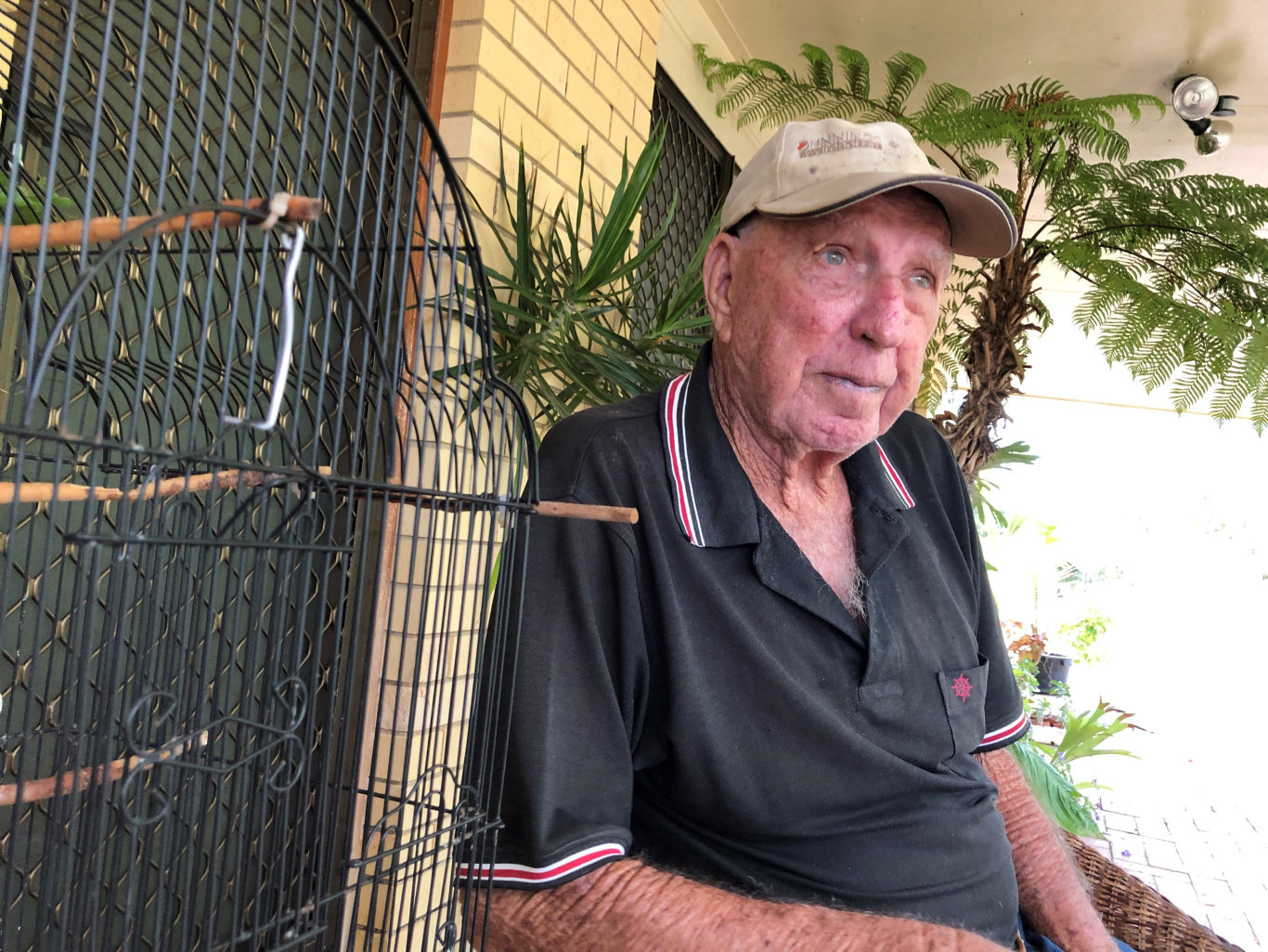 Hervey Bay's Aubrey McMullen with his bird's cage. His bird, named Ben, was killed during a dog attack.