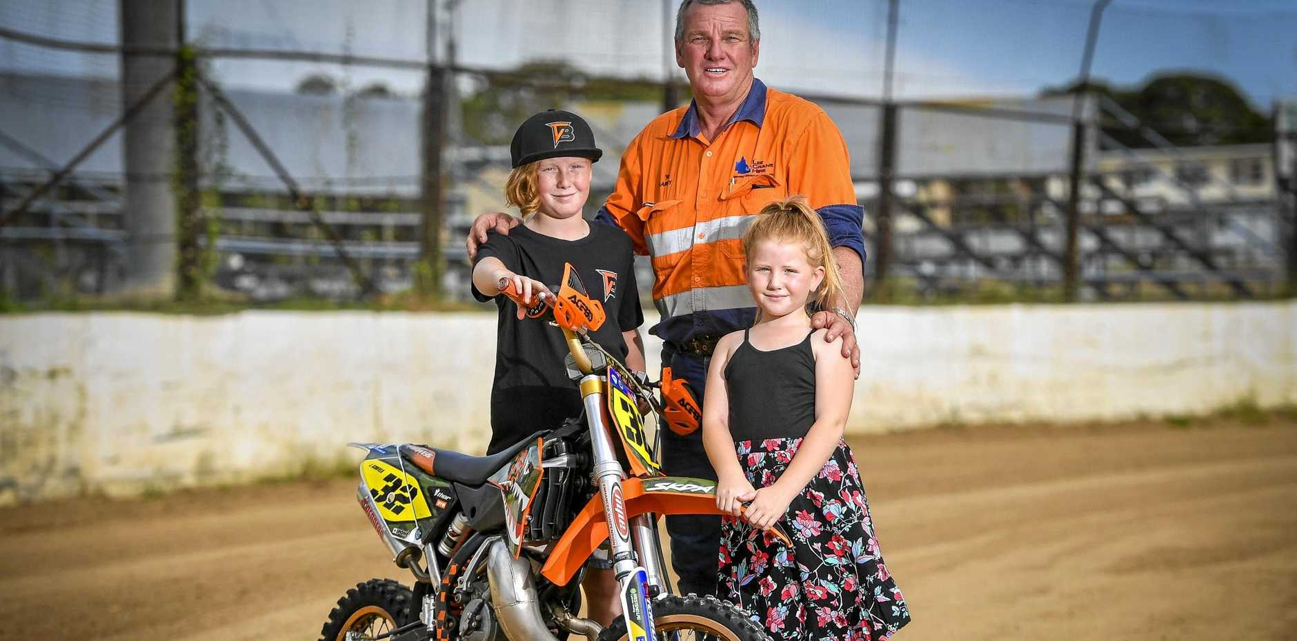 ON TRACK: Garry Schofield with his grandchildren and fellow riders Jaidyn, 11, and Maddison, 7. He said it's all positive for the fledgling club.