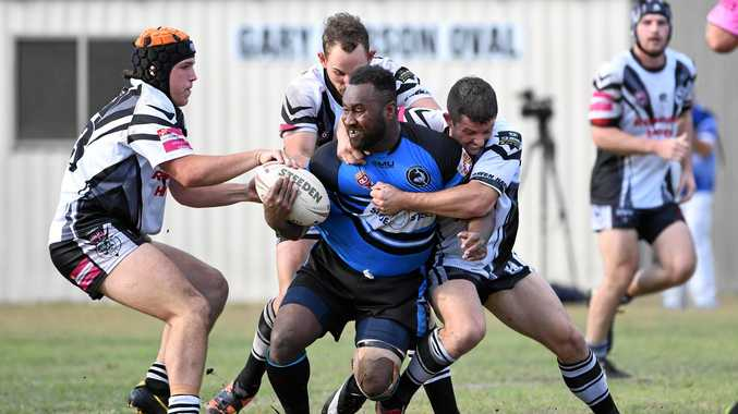South Kolan's Simione Butulovo is tackled by a pack of Miriam Vale players. The sides face each other in round one.
