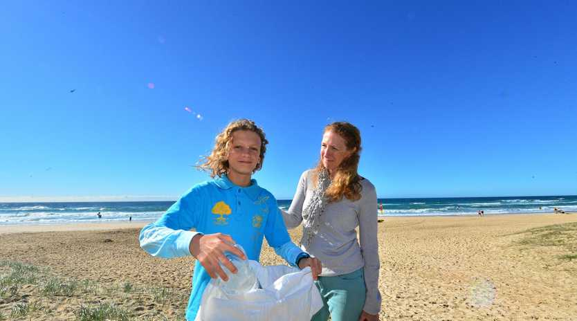 PLASTIC WAR: Liam Previti, 13, with mum Michelle. Liam has organised a clean-up for Peregian Beach.