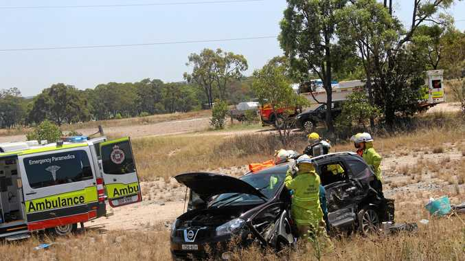 Emergency crews work to free a driver from their vehicle after a three vehicle collision.