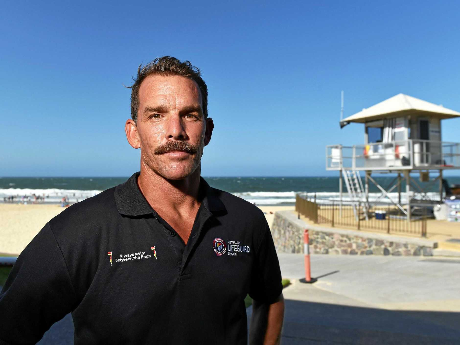 Ex-Tropical Cylone brings only bad memories to Coast lifeguard Trent Robinson, and Oma could be worse. The severe cyclone in 2005 knocked the Mooloolaba tower, pictured behind him, to the ground.