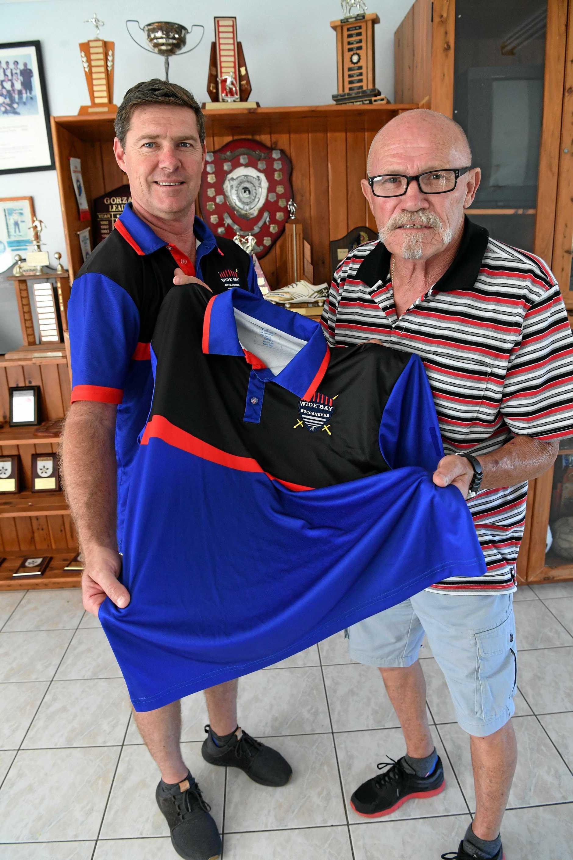 Buccaneers coach Karl Herdle with Peter Guest.