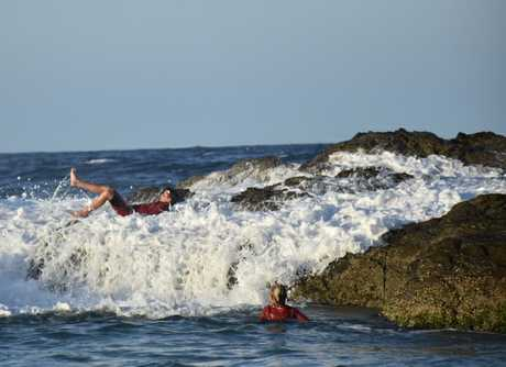A youth is swept off his feet by a wave at Snapper Rocks on the Gold Coast on Tuesday evening.